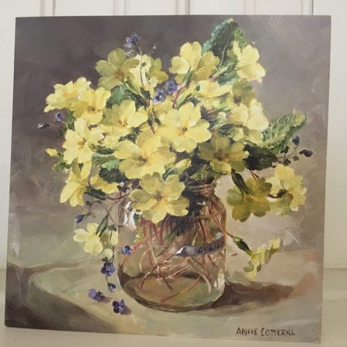 Primroses in glass jar