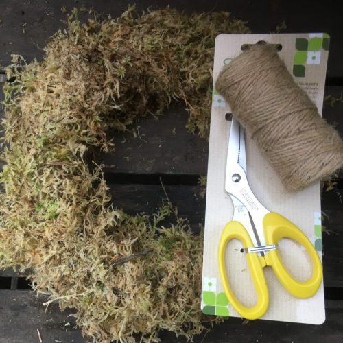 Mossed wreath, twine and florist scissors